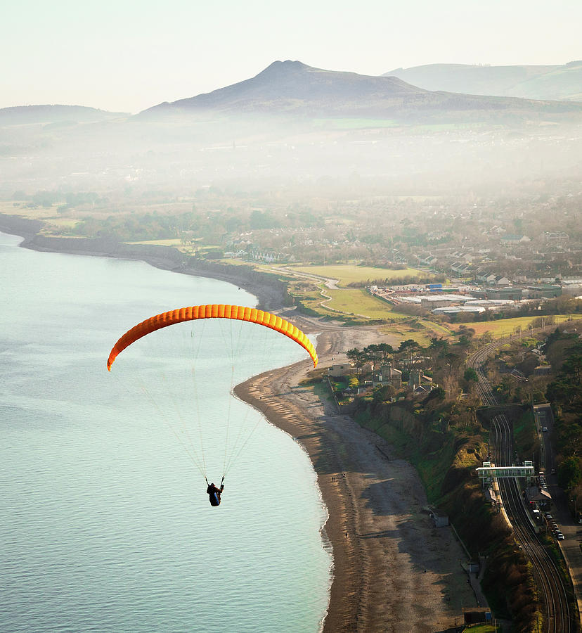 Vertical Photograph - Paragliding Off Killiney Hill by David Soanes Photography