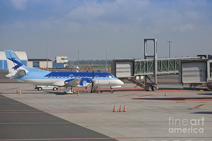 Air Travel Photograph - Parked Airplane At An Airport Gate by Jaak Nilson
