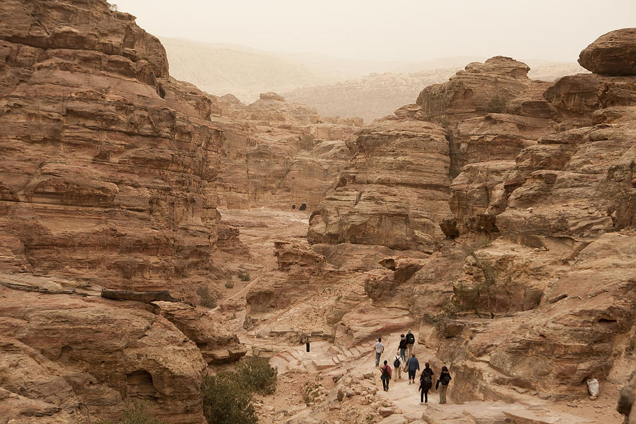 Petra Photograph - People Walk Along A Path by Taylor S. Kennedy