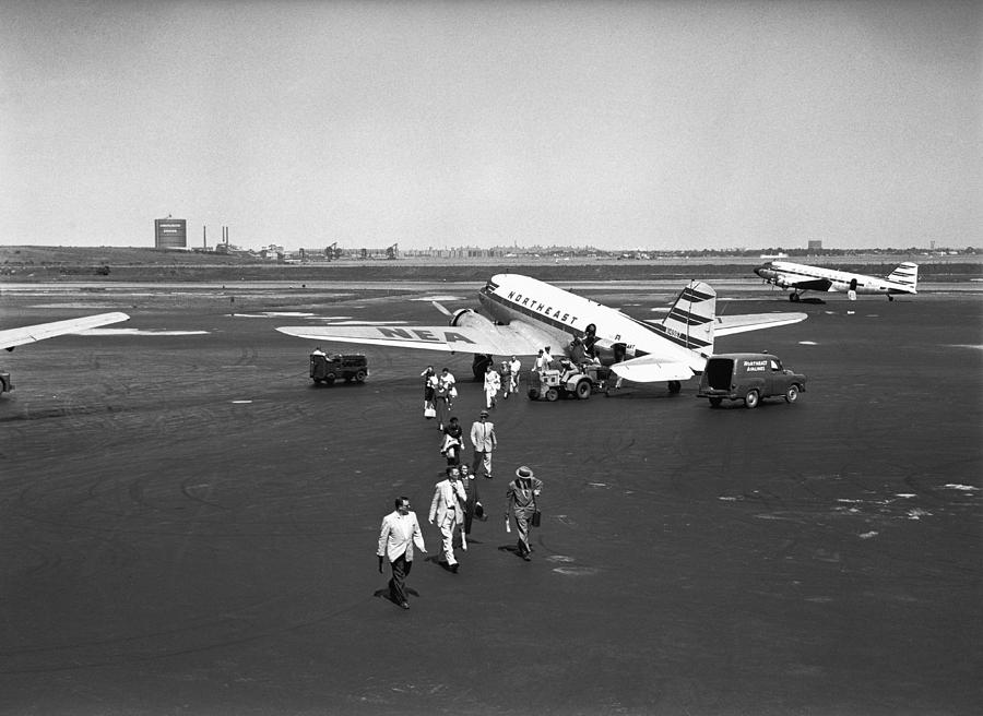 Adult Photograph - People Walking On Runway, (b&w), Elevated View by George Marks