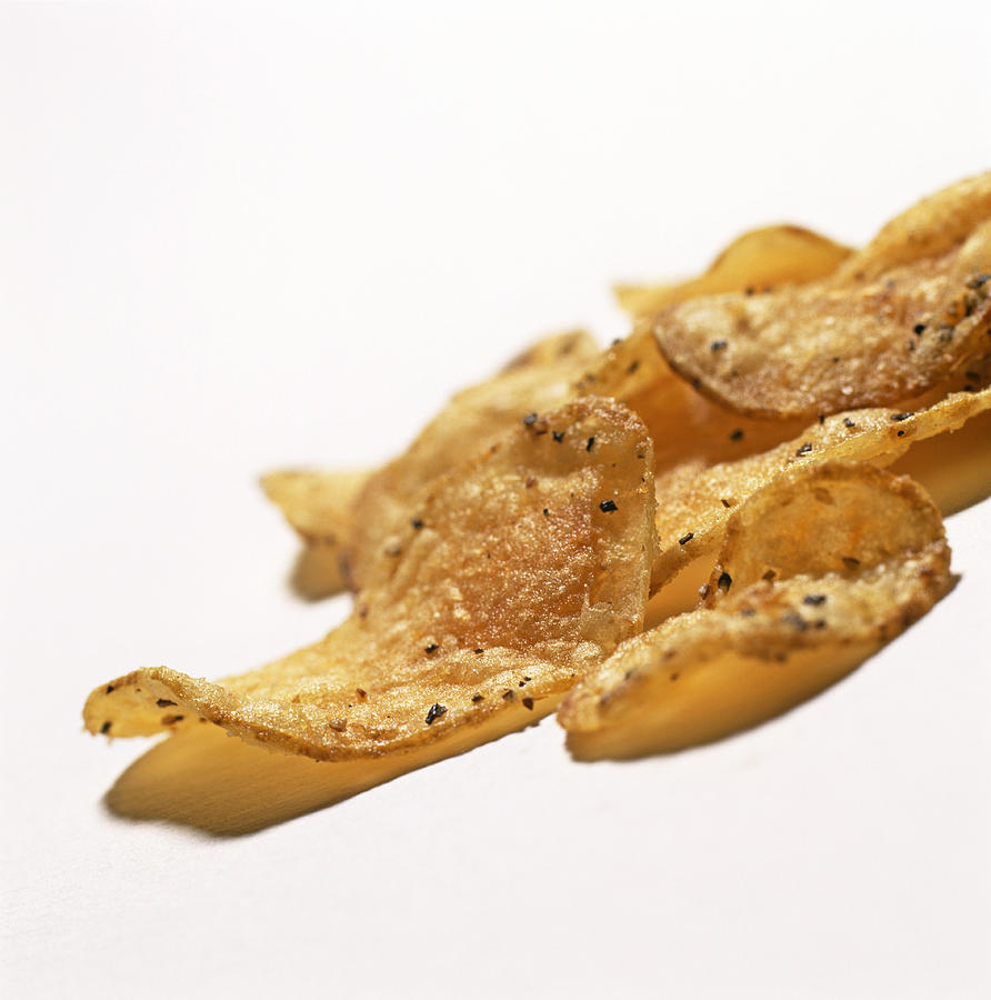 Crisp Photograph - Peppered Crisps by Kevin Curtis
