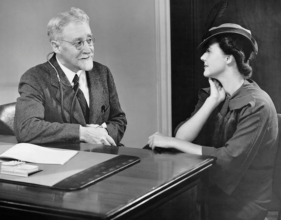 Adult Photograph - Physician Talking To Patient by George Marks