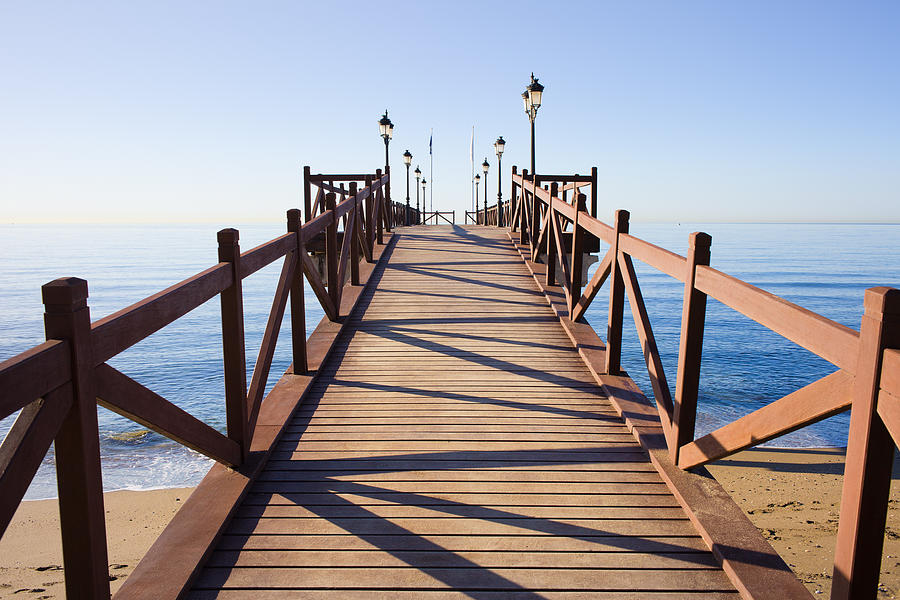 Pier Photograph - Pier On Costa Del Sol In Marbella by Artur Bogacki
