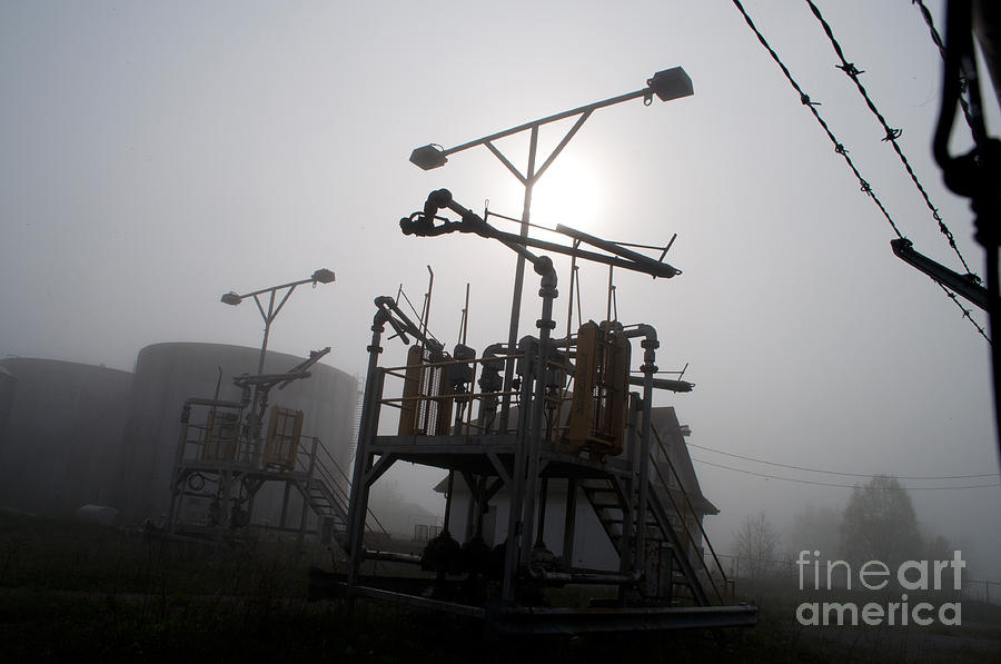 Industrial Photograph - Platforms And Tanks At Petrocor In The Fog by Gary Chapple