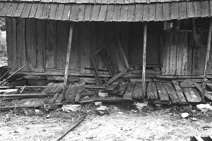 History Photograph - Porch Of A Barely Standing Home by Everett
