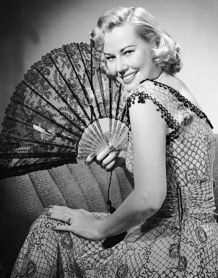 Adult Photograph - Portrait Of Blonde Woman Holding Fan by George Marks
