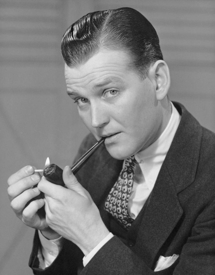 Adult Photograph - Portrait Of Businessman Lighting Pipe by George Marks