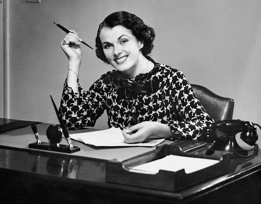 Adult Photograph - Portrait Of Businesswoman At Desk by George Marks