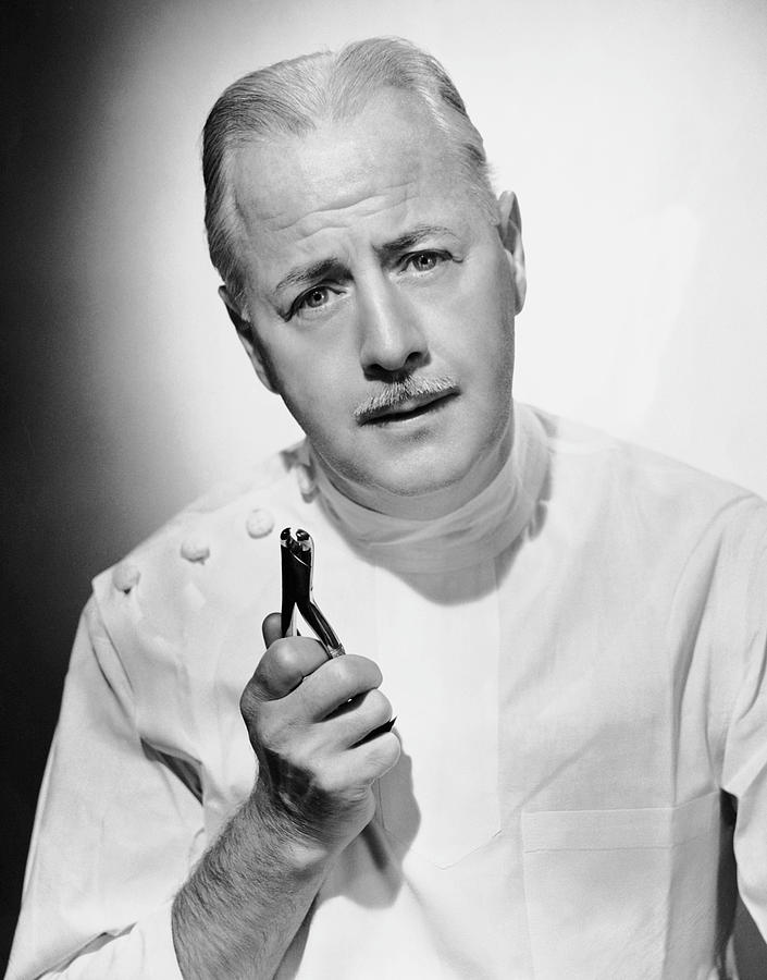Adult Photograph - Portrait Of Dentist With Medical Instrument by George Marks