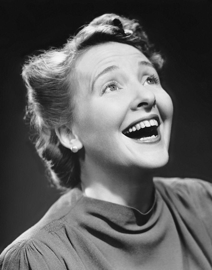 Adult Photograph - Portrait Of Happy Woman by George Marks
