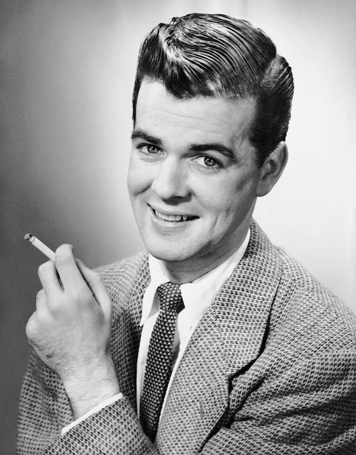 Adult Photograph - Portrait Of Man Holding A Cigarette by George Marks