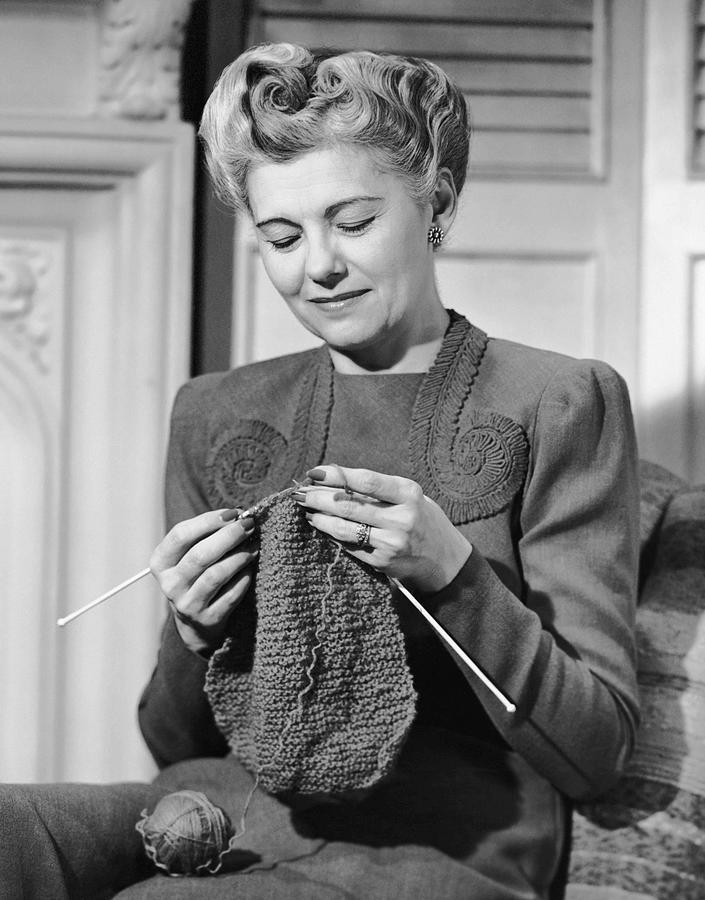 Adult Photograph - Portrait Of Mature Woman Crocheting by George Marks