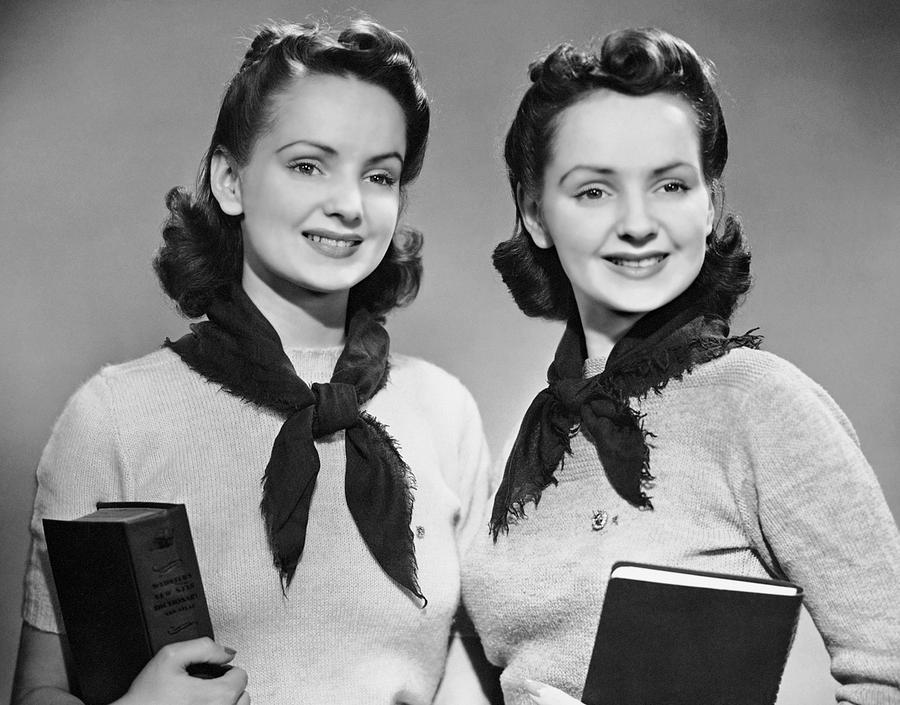 Teenager Photograph - Portrait Of Teenaged Twin Girls Holding Books by George Marks