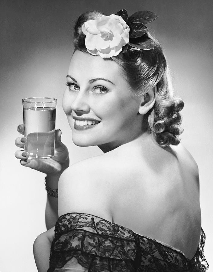 Adult Photograph - Portrait Of Woman Holding Glass Of Water by George Marks