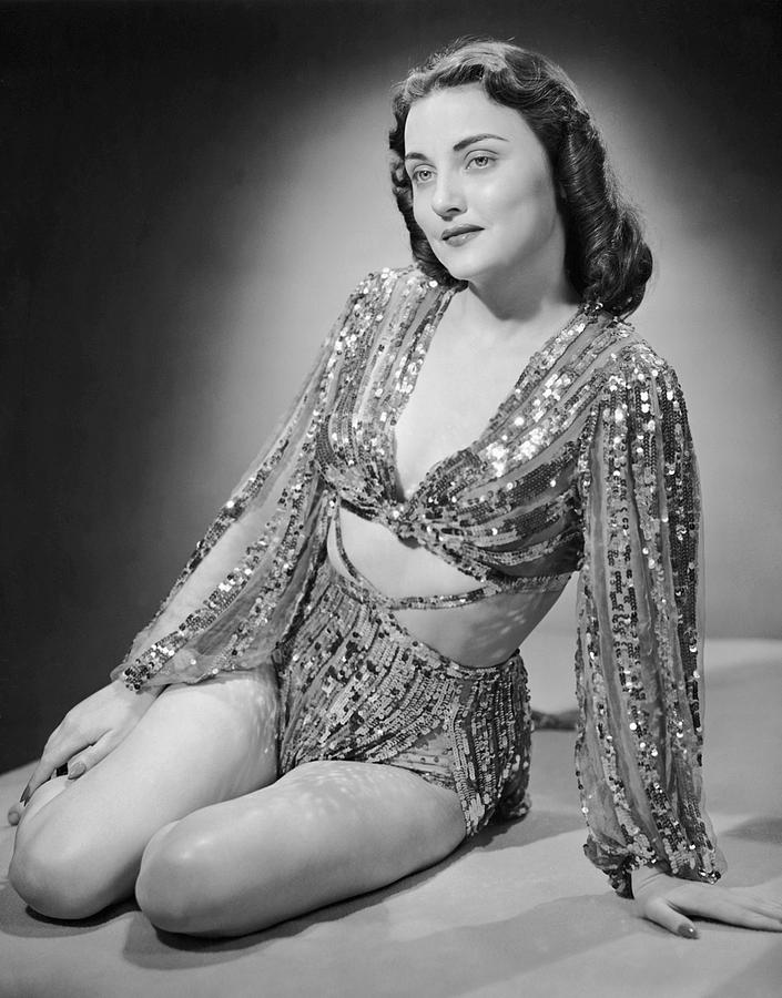 Adult Photograph - Portrait Of Woman In Lame Outfit by George Marks