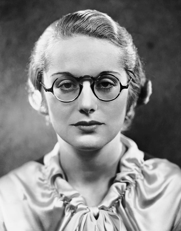 Adult Photograph - Portrait Of Woman Wearing Eyeglasses by George Marks