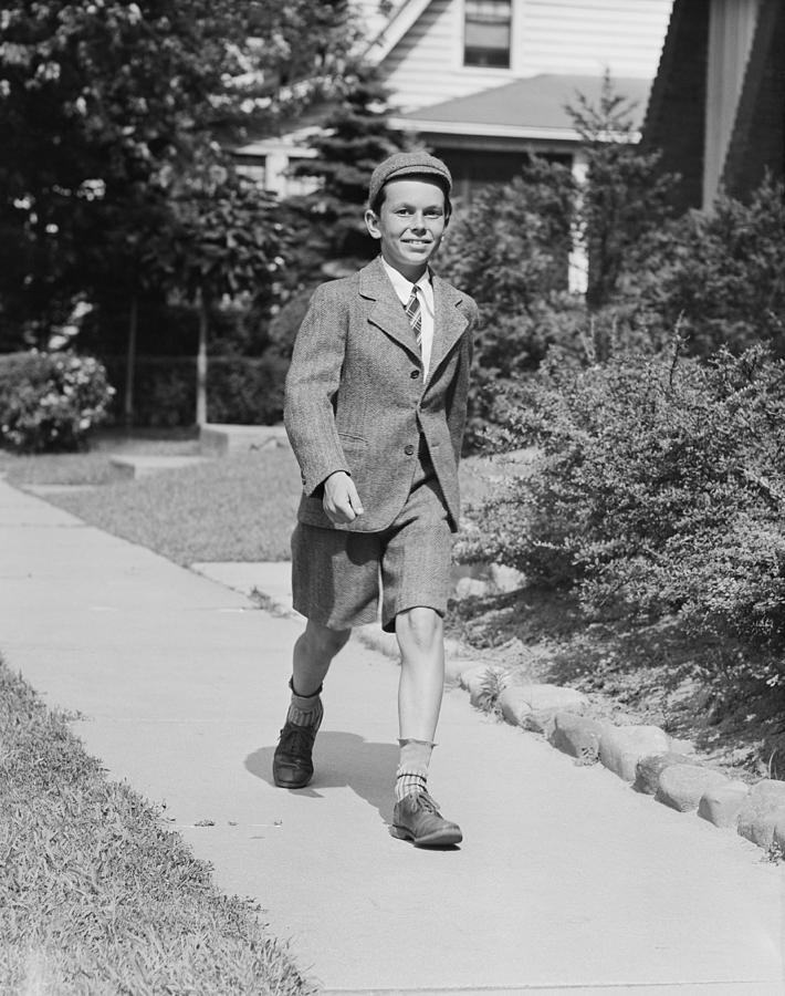 Child Photograph - Portrait Of Young Boy (12-13) Walking Along Sidewalk by George Marks