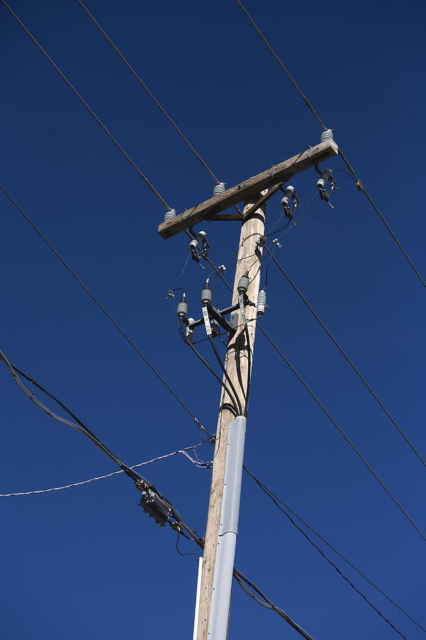 Blue Photograph - Power Lines Against A Clear Sky by John Burcham