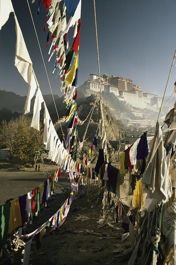 Asia Photograph - Prayer Flags Hang In The Breeze by Gordon Wiltsie