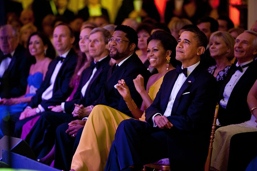 History Photograph - President And Michelle Obama Listen by Everett
