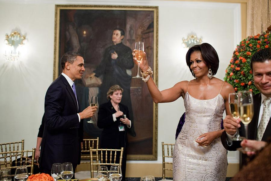History Photograph - President And Michelle Obama Toast by Everett