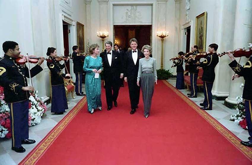 History Photograph - President And Nancy Reagan Walking by Everett