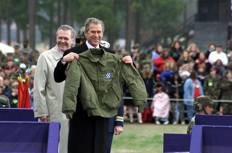 History Photograph - President Bush Displays A Jacket Given by Everett
