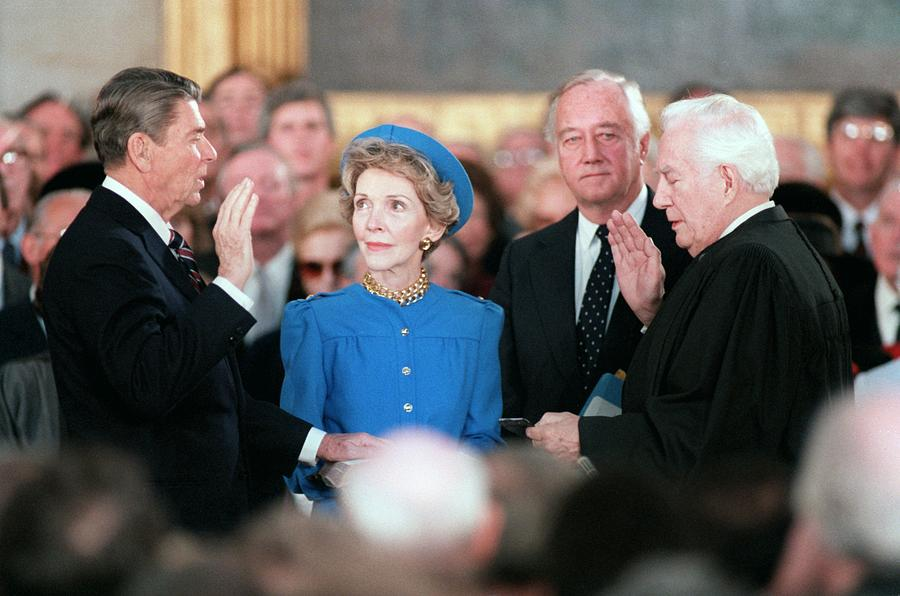 History Photograph - President Reagan Taking The Oath by Everett
