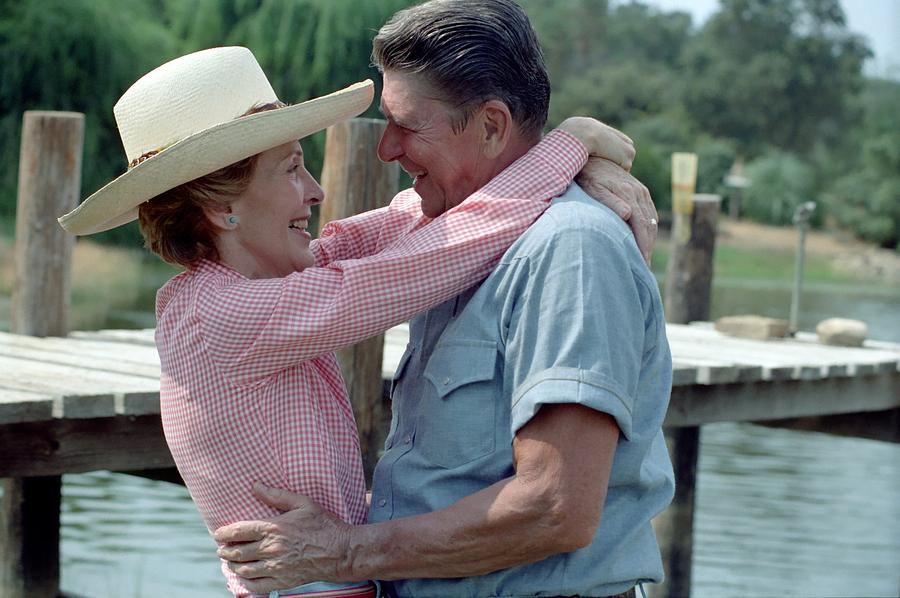 History Photograph - President Ronald And Nancy Reagan In An by Everett