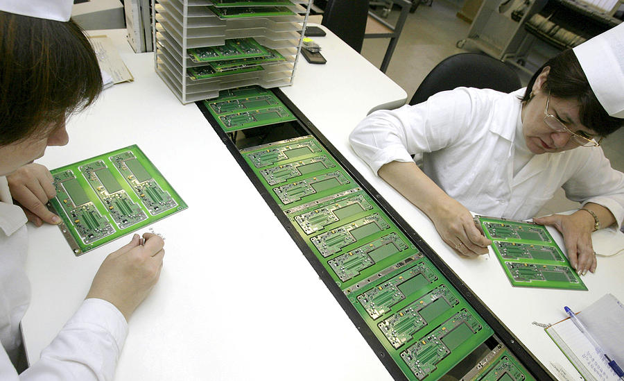 Electronic Circuit Photograph - Printed Circuit Board Assembly Work by Ria Novosti