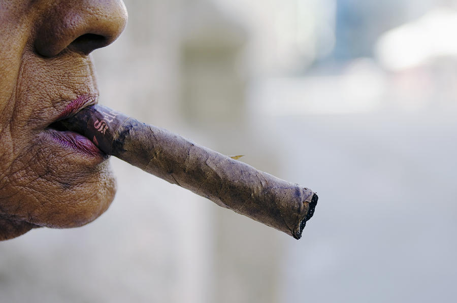 Adult Photograph - Profile Of Cuban Woman Smoking Cigar In Vieja District by Christian Aslund