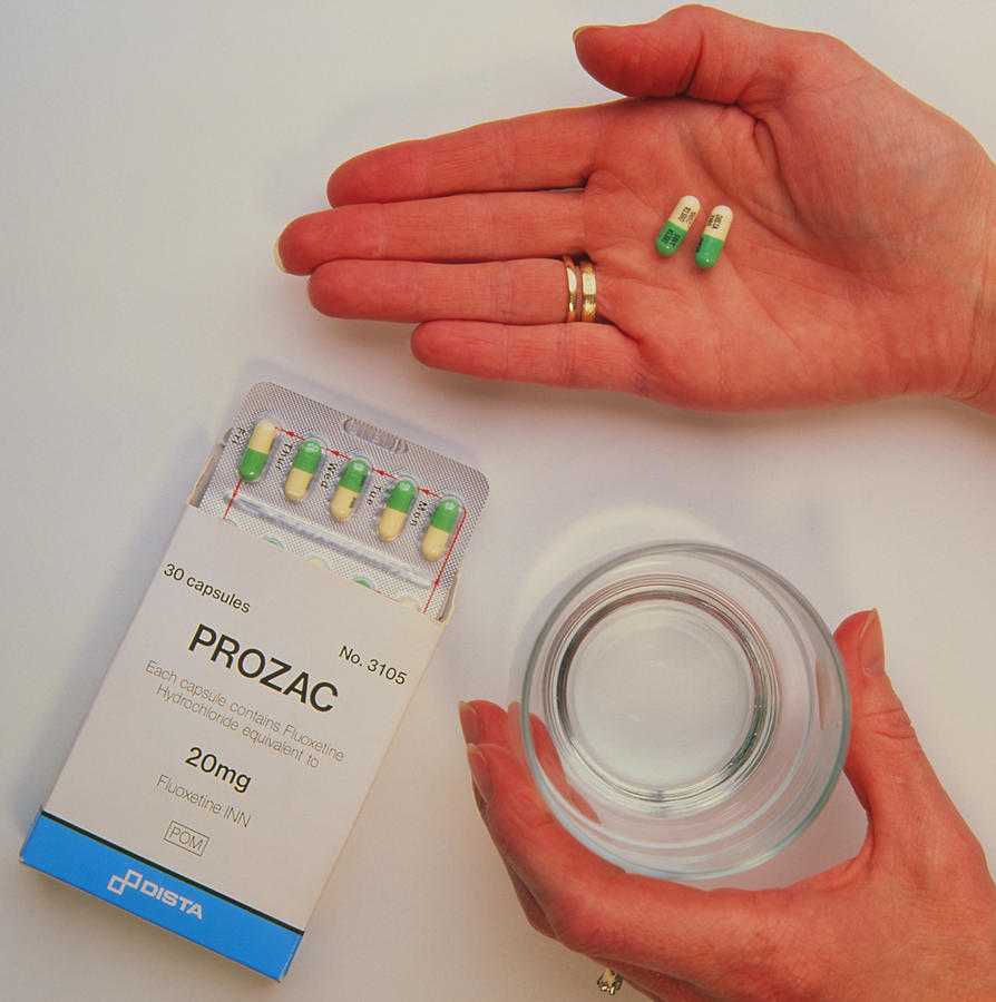 Antidepressant Drug Photograph - Prozac Pack With Pills In Hand And Glass Of Water by Damien Lovegrove