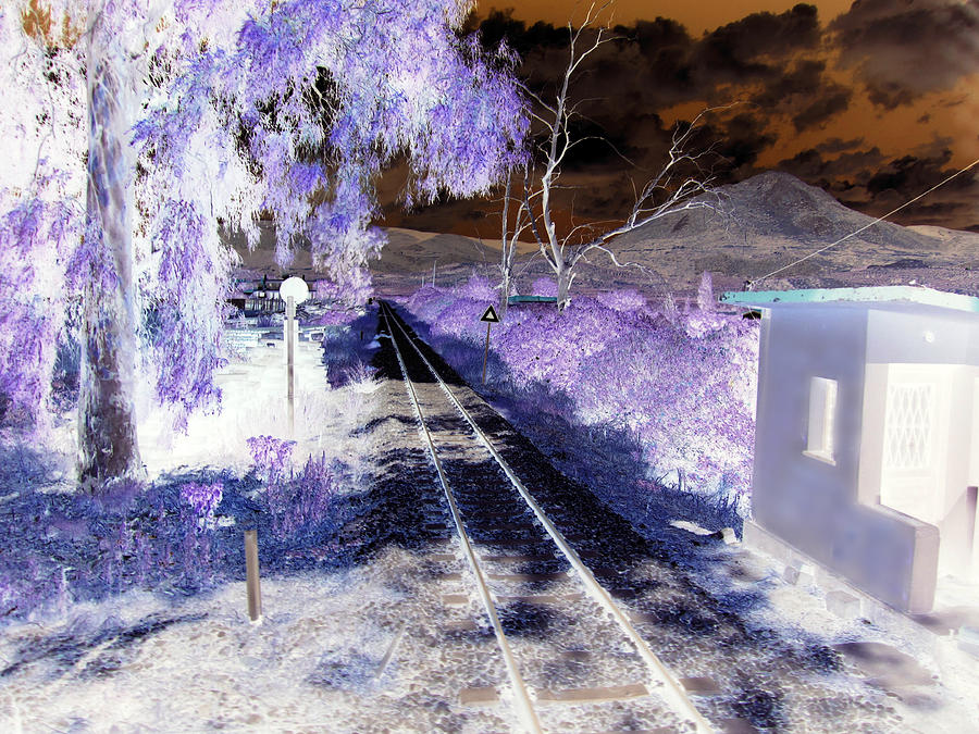 Railroad Crossing Glowing At Night In Negative Xray Look On The Way From  Mycenae To Olympia Greece