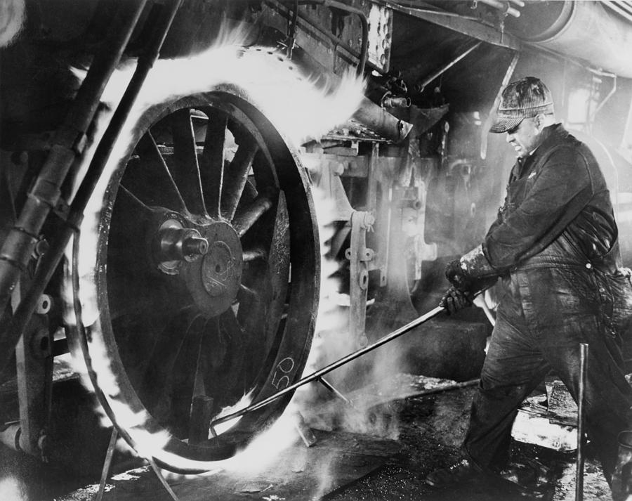 History Photograph - Railroad Worker Sweating A Tire by Everett