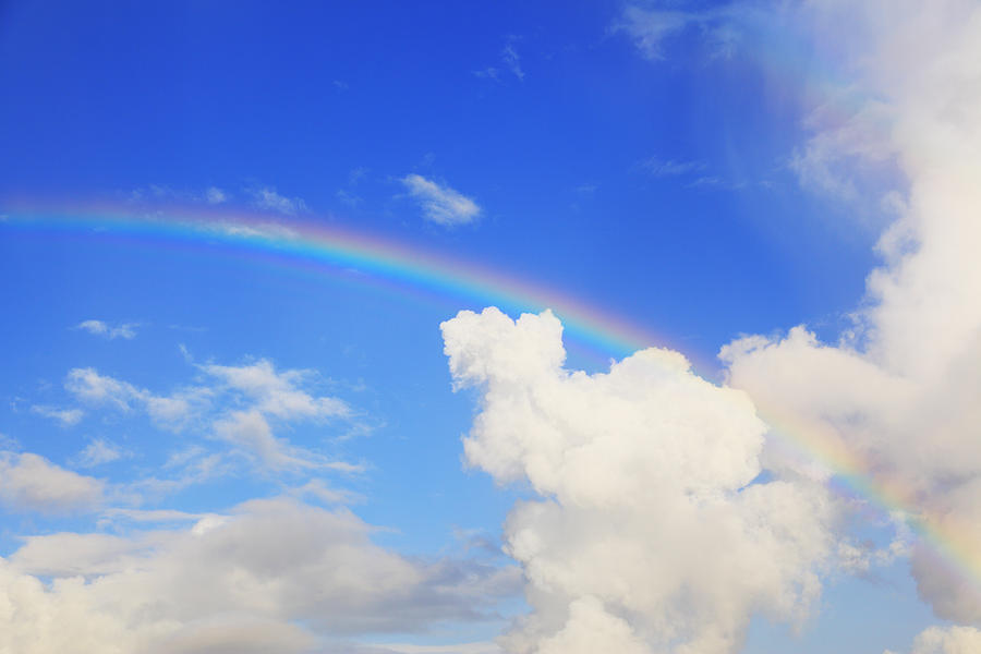rainbow over cloud photograph by imagewerks