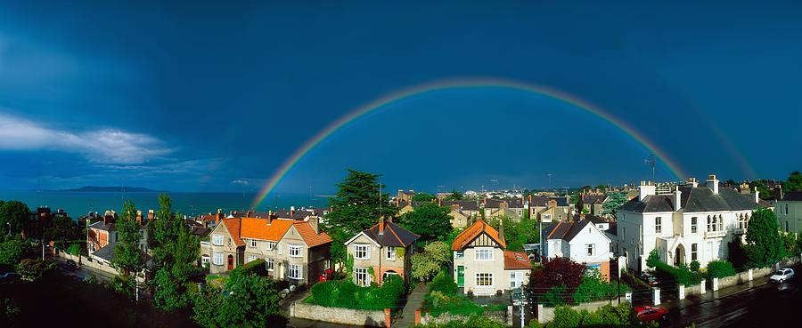 Atmosphere Photograph - Rainbow Over Housing, Monkstown, Co by The Irish Image Collection
