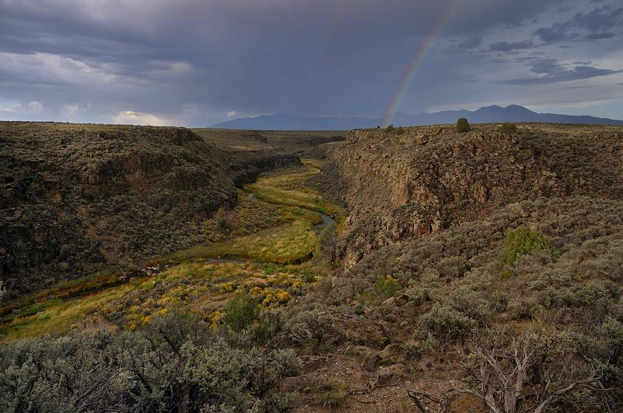 Landscape Photograph - Rainbow Over The Rio Pueblo by Ron Cline