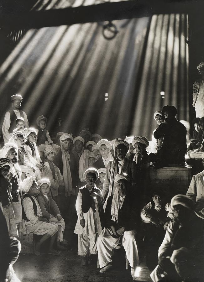 Day Photograph - Rays Of Sunlight Shine On Men And Boys by Maynard Owen Williams
