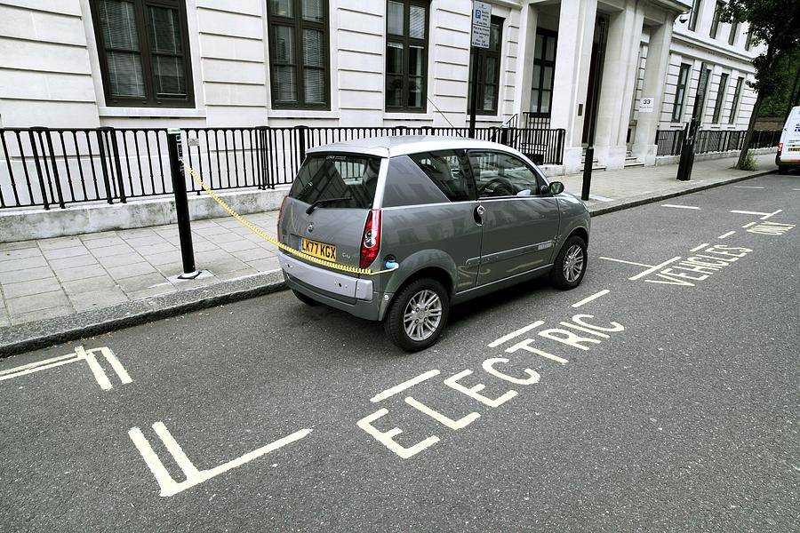 Mega City Photograph - Recharging An Electric Car by Martin Bond