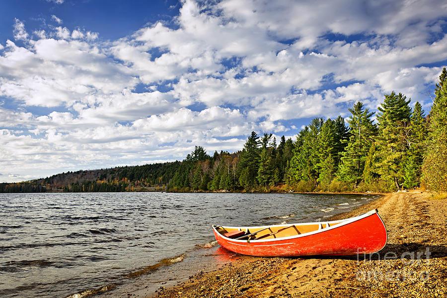 Canoe Photograph - Red Canoe On Lake Shore by Elena Elisseeva