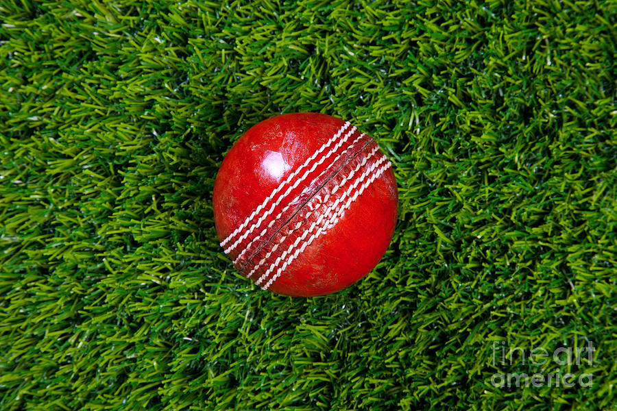 Red Leather Cricket Ball On Grass Photograph By Richard Thomas