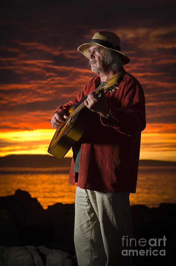 Acoustic Photograph - Red Sky Guitarist by David Lade