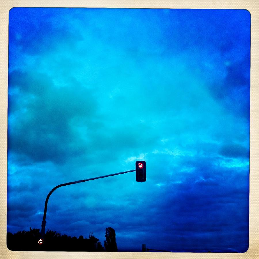 Traffic Light Photograph - Red traffic light and cloudy blue sky by Matthias Hauser