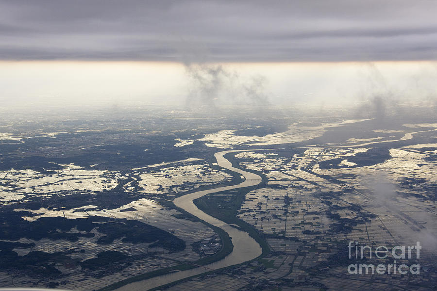 Aerial Photograph - River Running Through A Flooded Countryside by Jeremy Woodhouse