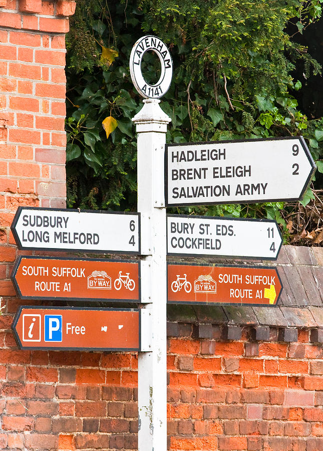Brick Photograph - Road Signs by Tom Gowanlock