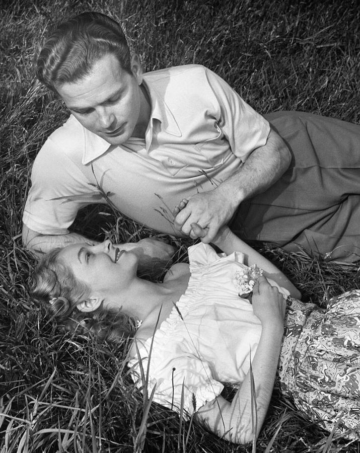 Adult Photograph - Romantic Couple In Meadow by George Marks