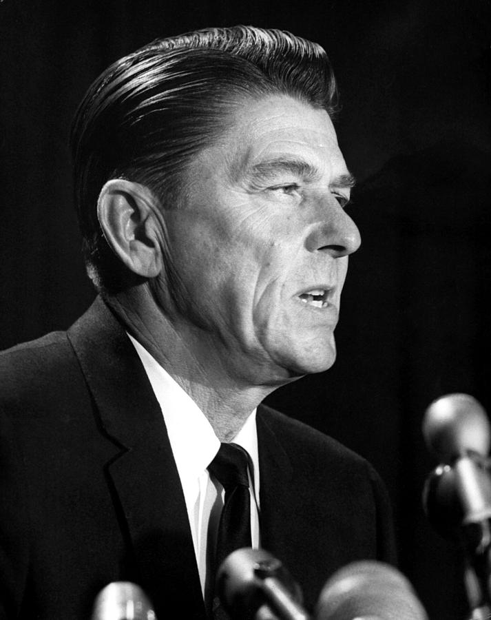 Candid Photograph - Ronald Reagan At A Press Conference by Everett