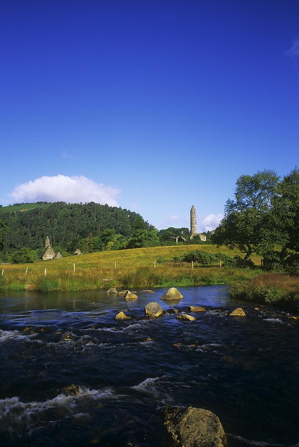 Abbeys Photograph - Round Tower And River In The Forest by The Irish Image Collection