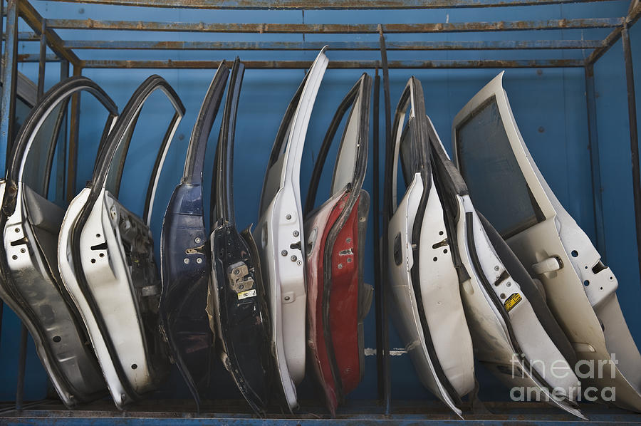 Automobiles Photograph - Row Of Dismantled Car Doors by Noam Armonn