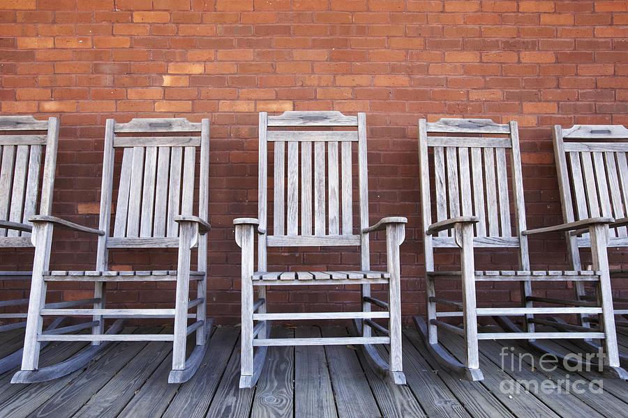 Brick Photograph - Row Of Rocking Chairs by Skip Nall
